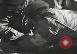 Image of Wounded of the 442nd Regimental Combat Team being treated Belmont France, 1944, second 12 stock footage video 65675065595