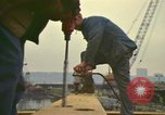 Image of construction site New York City USA, 1972, second 10 stock footage video 65675065609