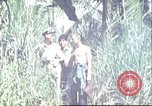 Image of native village Pacific Theater, 1944, second 6 stock footage video 65675065674