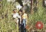 Image of native village Pacific Theater, 1944, second 7 stock footage video 65675065674