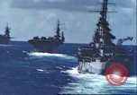 Image of U.S. warships fire at Japanese aircraft Pacific Theater, 1944, second 10 stock footage video 65675065676