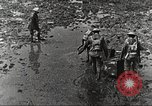 Image of British soldiers in muddy battle in World War 1 France, 1916, second 3 stock footage video 65675066066