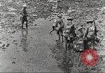 Image of British soldiers in muddy battle in World War 1 France, 1916, second 4 stock footage video 65675066066