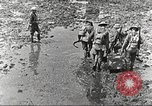 Image of British soldiers in muddy battle in World War 1 France, 1916, second 5 stock footage video 65675066066
