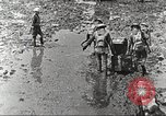 Image of British soldiers in muddy battle in World War 1 France, 1916, second 6 stock footage video 65675066066