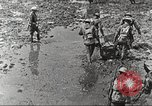 Image of British soldiers in muddy battle in World War 1 France, 1916, second 7 stock footage video 65675066066
