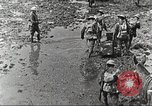 Image of British soldiers in muddy battle in World War 1 France, 1916, second 8 stock footage video 65675066066