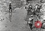 Image of British soldiers in muddy battle in World War 1 France, 1916, second 9 stock footage video 65675066066