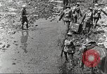 Image of British soldiers in muddy battle in World War 1 France, 1916, second 10 stock footage video 65675066066