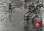 Image of British soldiers in muddy battle in World War 1 France, 1916, second 11 stock footage video 65675066066