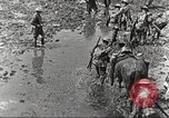 Image of British soldiers in muddy battle in World War 1 France, 1916, second 12 stock footage video 65675066066