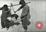 Image of poor children China, 1932, second 10 stock footage video 65675066270