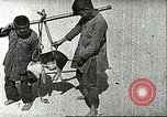 Image of poor children China, 1932, second 12 stock footage video 65675066270