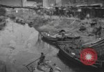 Image of lives of workers Shanghai China, 1928, second 1 stock footage video 65675066304