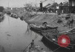 Image of lives of workers Shanghai China, 1928, second 3 stock footage video 65675066304