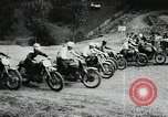 Image of motorcycle dirtbike race Tarn France, 1956, second 4 stock footage video 65675066318