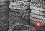 Image of tire remover United States USA, 1947, second 10 stock footage video 65675066620