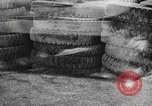 Image of tire remover United States USA, 1947, second 11 stock footage video 65675066620