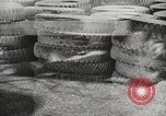 Image of tire remover United States USA, 1947, second 12 stock footage video 65675066620