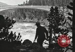 Image of Chittenden bridge crossing the Yellowstone River United States USA, 1917, second 2 stock footage video 65675066826