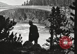 Image of Chittenden bridge crossing the Yellowstone River United States USA, 1917, second 5 stock footage video 65675066826