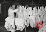 Image of shirts ironed and mended Chicago Illinois USA, 1917, second 12 stock footage video 65675066830