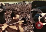 Image of M1A1 155mm gun Peleliu Palau Islands, 1944, second 1 stock footage video 65675067107
