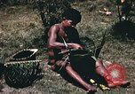 Image of native man Pacific Theater, 1945, second 4 stock footage video 65675067201