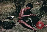 Image of native man Pacific Theater, 1945, second 6 stock footage video 65675067201