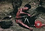 Image of native man Pacific Theater, 1945, second 7 stock footage video 65675067201