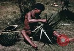 Image of native man Pacific Theater, 1945, second 8 stock footage video 65675067201