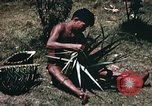 Image of native man Pacific Theater, 1945, second 9 stock footage video 65675067201