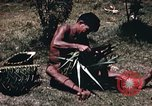 Image of native man Pacific Theater, 1945, second 10 stock footage video 65675067201