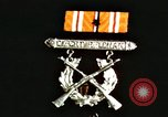 Image of medals on coat Mariana Islands, 1945, second 1 stock footage video 65675067213