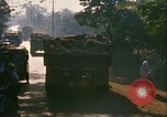 Image of trucks loaded with rice Vietnam, 1968, second 11 stock footage video 65675067226