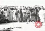 Image of Outdoor performers entertain spectators in Marrakech Morocco North Africa, 1942, second 1 stock footage video 65675067432
