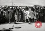 Image of Outdoor performers entertain spectators in Marrakech Morocco North Africa, 1942, second 4 stock footage video 65675067432