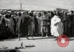 Image of Outdoor performers entertain spectators in Marrakech Morocco North Africa, 1942, second 5 stock footage video 65675067432