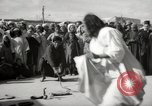 Image of Outdoor performers entertain spectators in Marrakech Morocco North Africa, 1942, second 7 stock footage video 65675067432