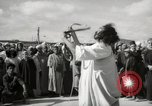 Image of Outdoor performers entertain spectators in Marrakech Morocco North Africa, 1942, second 9 stock footage video 65675067432
