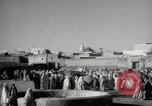 Image of Camels offered for sale at outdoor market in Marrakech Morocco North Africa, 1942, second 4 stock footage video 65675067433