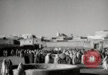 Image of Camels offered for sale at outdoor market in Marrakech Morocco North Africa, 1942, second 10 stock footage video 65675067433