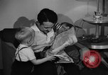 Image of family of American automobile worker Detroit Michigan USA, 1950, second 12 stock footage video 65675067510