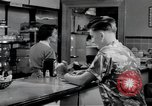 Image of activities of a family United States USA, 1951, second 11 stock footage video 65675067541