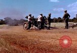 Image of 1st Cavalry Division artillerymen firing 105mm Howitzer Plei Me Vietnam, 1965, second 5 stock footage video 65675067579