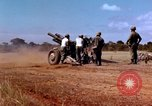 Image of 1st Cavalry Division artillerymen firing 105mm Howitzer Plei Me Vietnam, 1965, second 7 stock footage video 65675067579