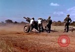 Image of 1st Cavalry Division artillerymen firing 105mm Howitzer Plei Me Vietnam, 1965, second 8 stock footage video 65675067579