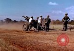 Image of 1st Cavalry Division artillerymen firing 105mm Howitzer Plei Me Vietnam, 1965, second 9 stock footage video 65675067579