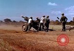 Image of 1st Cavalry Division artillerymen firing 105mm Howitzer Plei Me Vietnam, 1965, second 10 stock footage video 65675067579