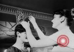 Image of girls display bonnet London England United Kingdom, 1953, second 11 stock footage video 65675067641